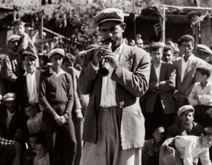 Zurna player and the wedding guests at a mountain village wedding in Geben 1960